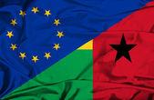 Waving flag of Guinea Bissau and EU — Stock Photo