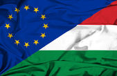 Waving flag of Hungary and EU — Stock Photo