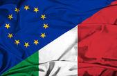 Waving flag of Italy and EU — ストック写真