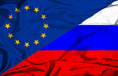 Waving flag of Russia and EU — Stock Photo