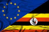 Развевающийся флаг Уганды и Ес — Стоковое фото