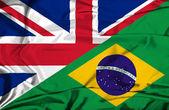 Waving flag of Brazil and UK — Stock Photo
