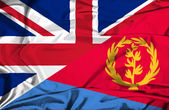 Waving flag of Eritrea and UK — Stock Photo