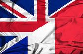 Waving flag of France and UK — Stock Photo