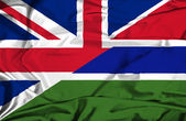 Waving flag of Gambia and UK — Stock Photo