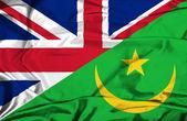 Waving flag of Mauritania and UK — Stock Photo