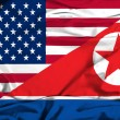 Waving flag of North Korea and USA — Zdjęcie stockowe