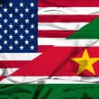 Waving flag of Suriname and USA — Stock Photo