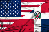 Waving flag of Dominican Republic and USA — Photo