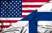 Waving flag of Finland and USA — Stock Photo