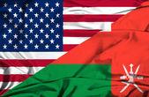 Waving flag of Oman and USA — Stock Photo