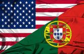 Waving flag of Portugal and USA — Stock Photo