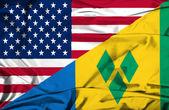 Waving flag of Saint Vincent and Grenadines and USA — Photo