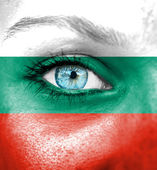 Woman face painted with flag of Bulgaria — Stock Photo