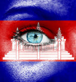 Woman face painted with flag of Cambodia — Stock Photo
