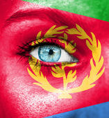 Woman face painted with flag of Eritrea — Stock Photo