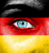 Woman face painted with flag of Germany — Stock Photo