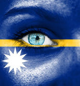 Woman face painted with flag of Nauru — Stock Photo