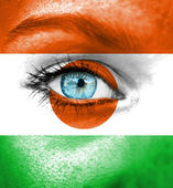Woman face painted with flag of Niger — Stock Photo