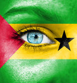 Woman face painted with flag of Sao Tome and Principe — Stock Photo