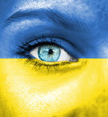 Woman face painted with flag of Ukraine — Stock Photo