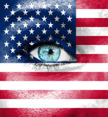 Woman face painted with flag of USA — Stockfoto