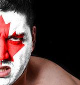 カナダの塗られた旗と怒っている男の肖像 — ストック写真