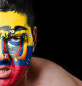 Portrait of angry man with painted flag of Ecuador — Stock Photo