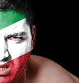 Portrait of angry man with painted flag of Italy — Stock Photo