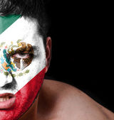 Portrait of angry man with painted flag of Mexico — Stock Photo