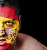 Portrait of angry man with painted flag of Spain — Stock Photo