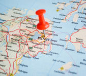 Close up of Belfast map with red pin - Travel concept — Stock Photo
