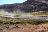 Steaming geothermal hot water Iceland — Stock Photo