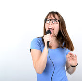 Portrait of a young female with microphone against white backgro — Stock Photo