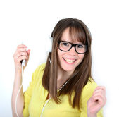 Woman dancing with headphones listening to music on mp3 — Stock Photo