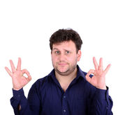 Portrait of handsome young man showing ok sign with hands isola — Stock Photo