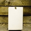 Old paper on wood panel — Stock Photo #8679589
