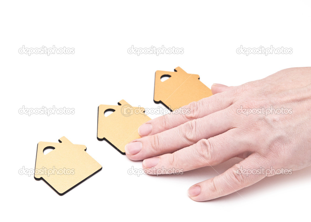Hand choosing small home   Stock Photo #12686228
