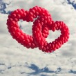 Two heart-shaped baloons in the sky, the symbols of love — Stock Photo