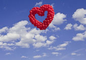 Heart-shaped baloons in the sky, the symbols of love — Stock Photo