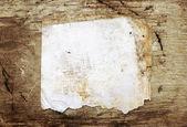 Grunge altpapier auf alten hölzernen hintergrund — Stockfoto