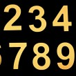 Stock Photo: Yellow metal numbers on black background