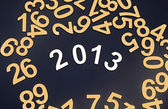 Digit 2013 and pile random numbers on black background — Stock Photo