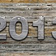 """2013"" number on old wood background — Stock Photo"