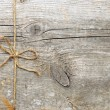 Stock Photo: String tied in a bow, over old wood