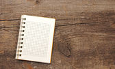 Open blank note book on grunge wood . With copy space — Stock Photo