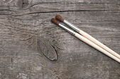 Old wood texture and paintbrush — Stock Photo