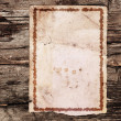 Vintage paper on old wood texture  — Stock Photo