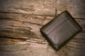 кошелек на фоне древесины — Стоковое фото