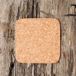 Cork memory board on old wooden background — Stock Photo